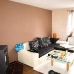 Innenraum Wohnung in Meinsdorf - Wohnzimmer Laminat Doppelfenster Hell Ofen Kamin- Märkisches Wohnen